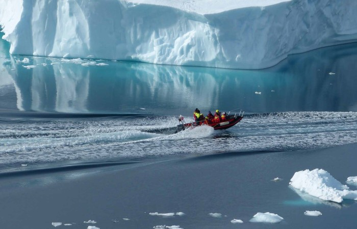 Adventure between the icebergs, Lemaire Channel, Antarctica.