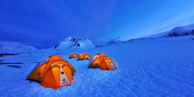 Pitch tents ashore in Antarctica