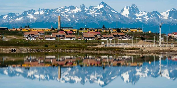 The snow clad mountains surrounding Ushuaia reflected in the channel on a clear, crisp morning.