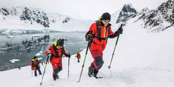 Hiking at Orne Harbour on one of our landings in Antarctica. On this expedition, we hope to cross the Polar Circle at 66°33' south, far beyond the limit of most cruises in Antarctica.
