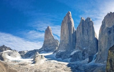 The Three Towers at Torres del Paine National Park, Patagonia, Chile. Deep valleys and snow-capped peaks create a stunning contrast with the lush coastal plain, which supports a rich variety of wildlife.