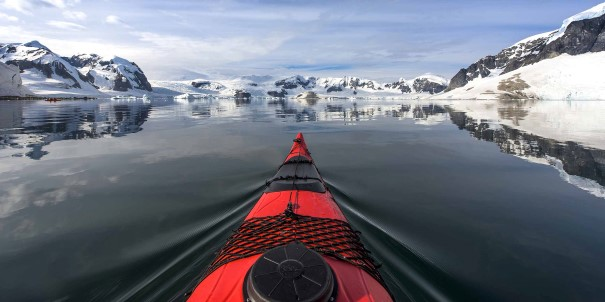 Our Expedition Team are skilled professionals who will take you on landings and exciting activities whenever conditions allow, like kayaking the icy waters of Antarctica.
