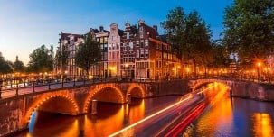 Amsterdam canal and light trails