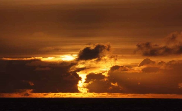 Dramatic clouds and sunset over the Denmark Strait