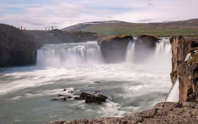 Experience the power of Goðafoss waterfall.