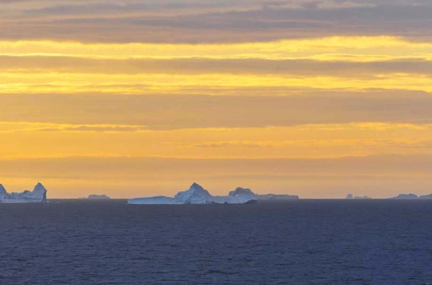 Amazing colours and icebergs in the sunset while crossing the Davis Strait.