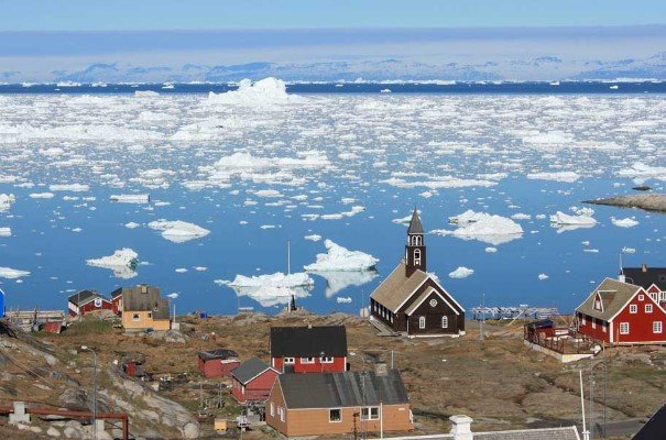 The views are majestic in the Ilulissat settlement, with icebergs scattered on the fjord.