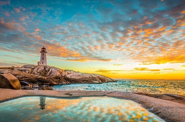 Peggy's Cove lighthouse at sunset.