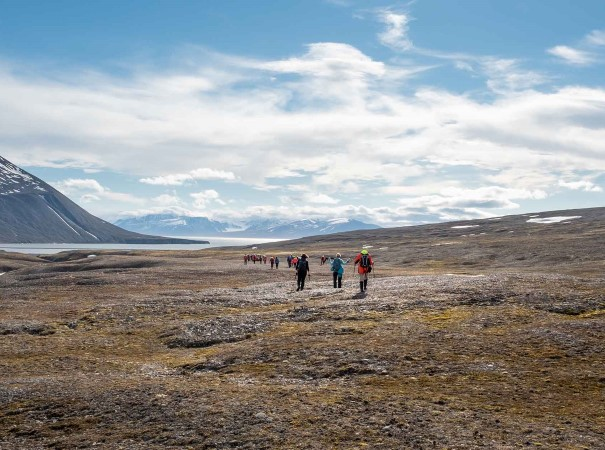 Hiking in Mushamna, Svalbard. Known as the `crown of Arctic Norway´, Svalbard is a beautiful island forged by the extreme elements of the far north. The area is also a biological hot spot and home to a rich array of wildlife, with the mighty polar bear at the top of the food chain.