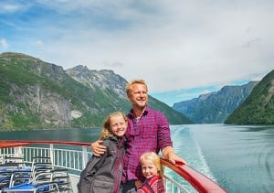 Family on board Hurtigruten in Geirangerfjord