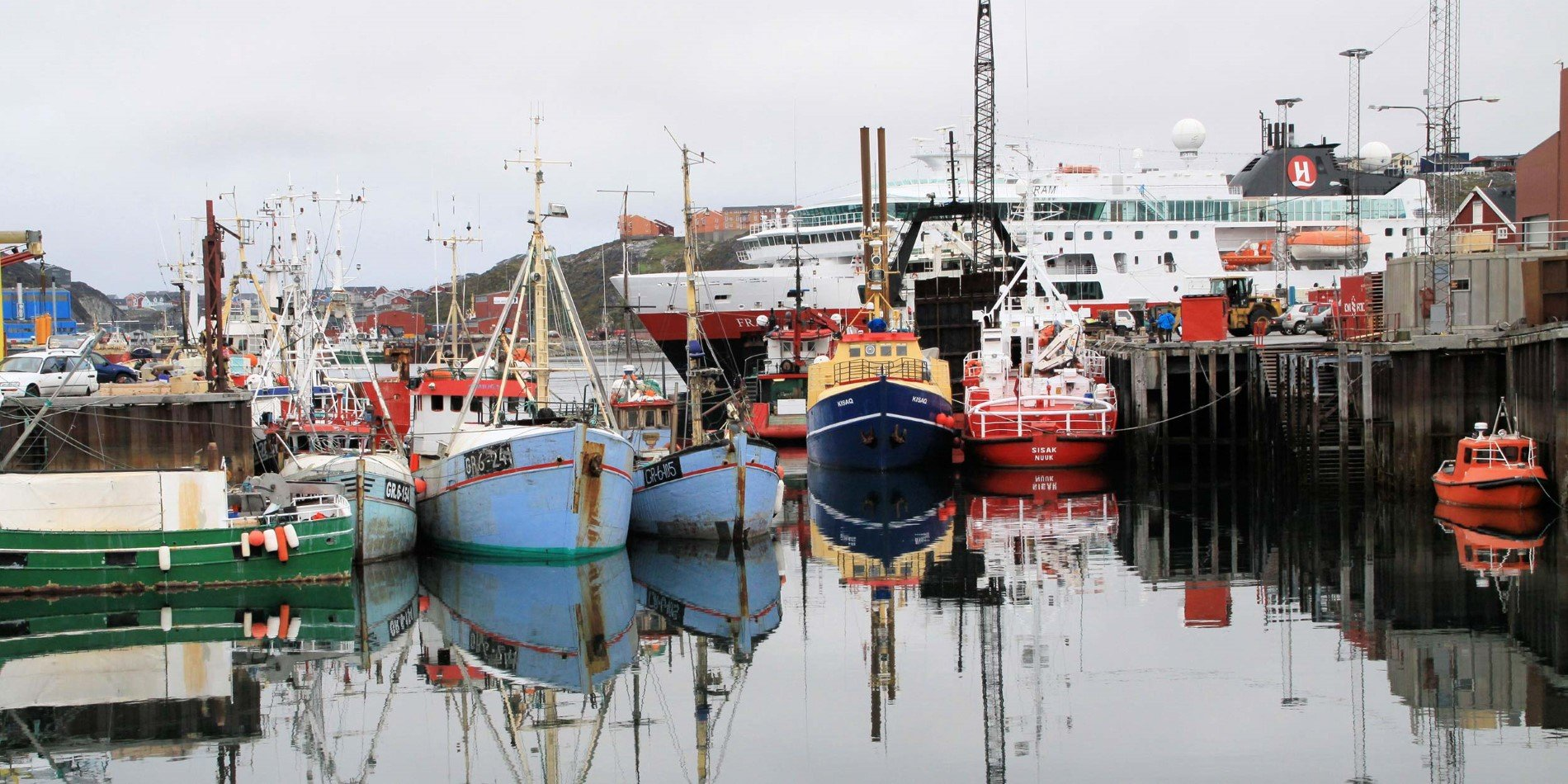 Hurtigruten in Nuuk harbour with fishing boats