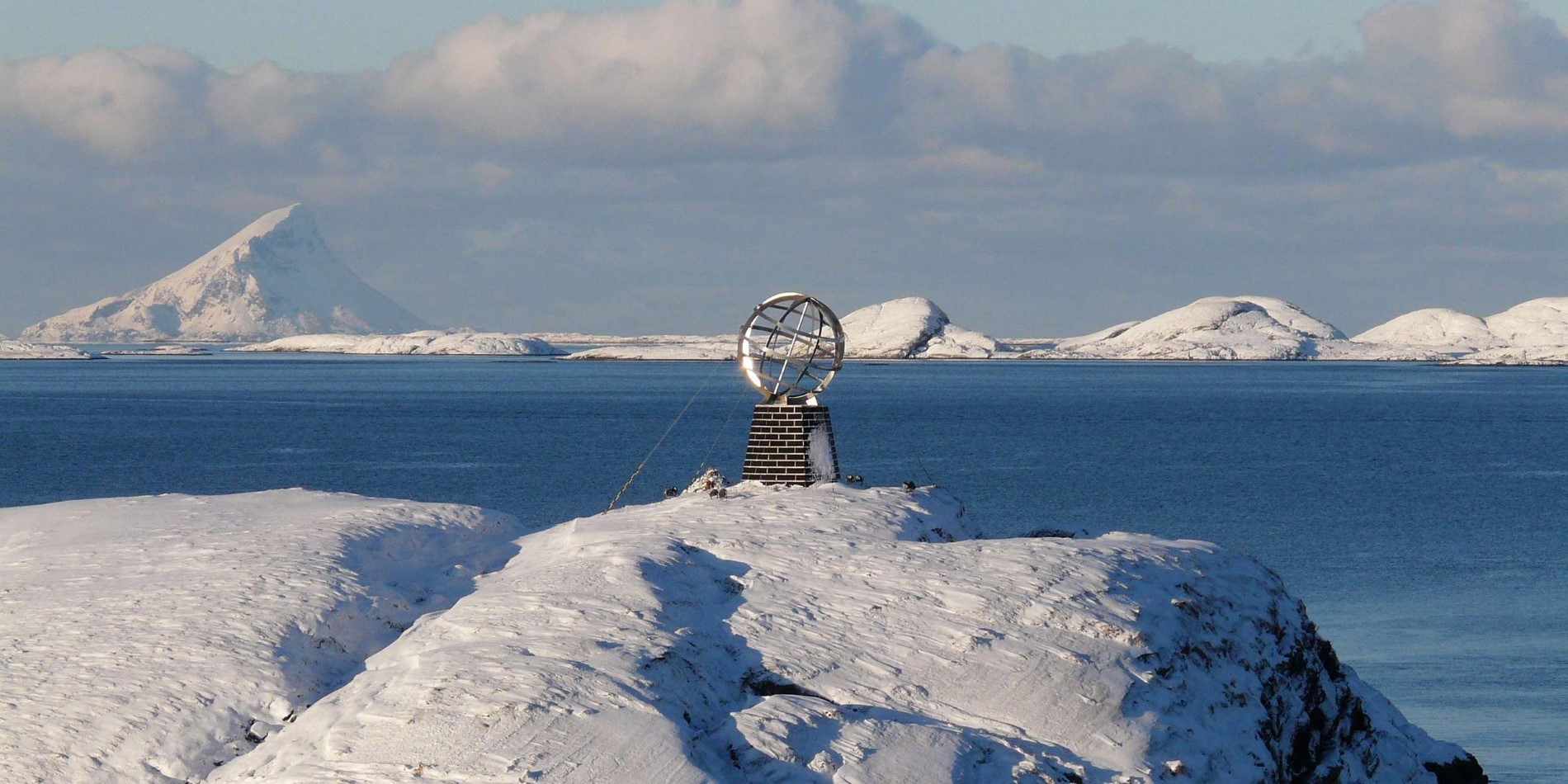 The Arctic Circle monument in winter