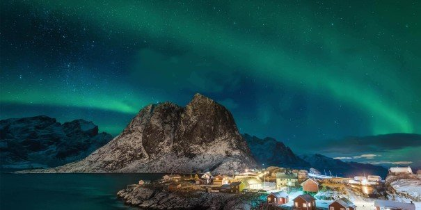 Hunt the aurora borealis in Norway with our Northern Lights Promise. If you don't see the lights on your Roundtrip, we give you another voyage (6-7 days) for free. Here over Hamnøy, Lofoten